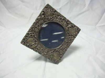 2011: STERLING FLORAL EMBOSSED PICTURE FRAME; APPROX 11