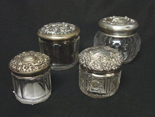 4007: FOUR DRESSER JARS W/STERLING TOPS