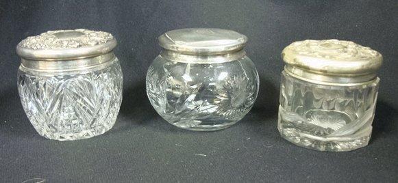 4018: THREE STERLING TOP DRESSER JARS