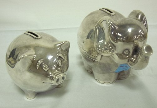 4125: 2 TIFFANY & CO STERLING SILVER PIGGY BANKS; 15.24