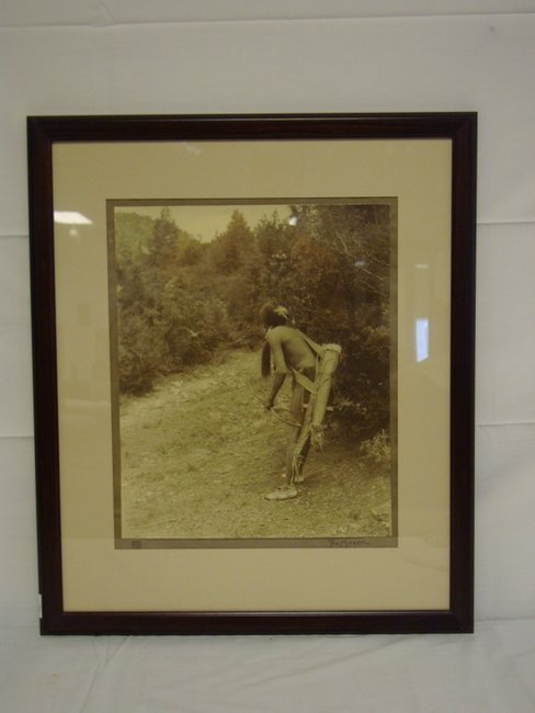 1165: FRAMED CARL MOON PHOTO OF AN INDIAN BRAVE; SIGNED