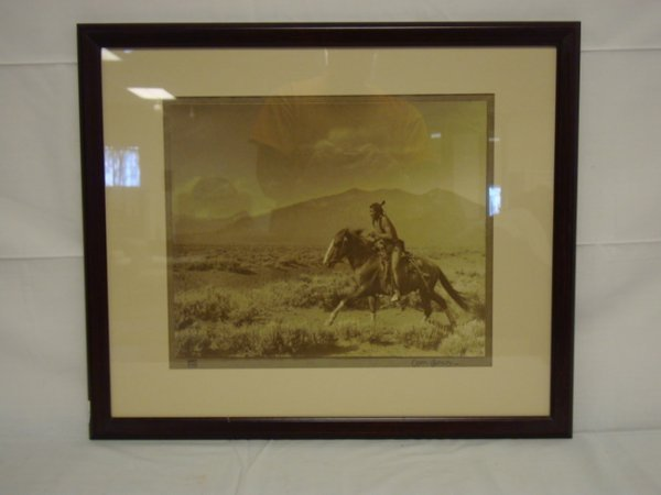 1167: FRAMED CARL MOON PHOTO OF AN INDIAN BRAVE ON HORS