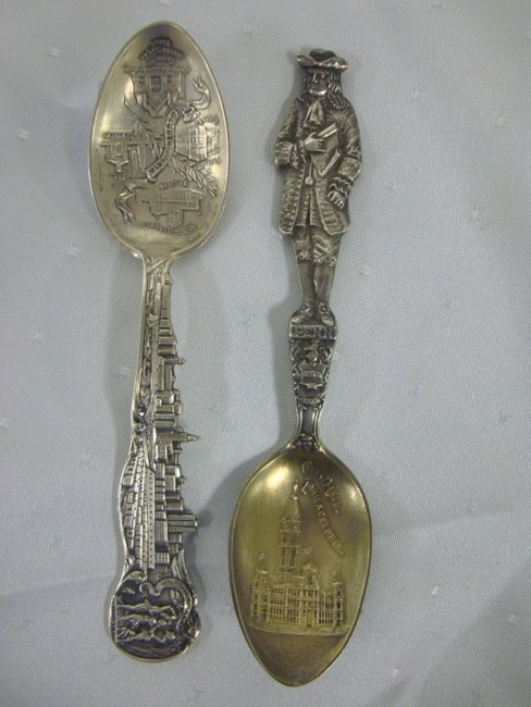 8: TWO STERLING SOUVENIER SPOONS; ONE HEAVILY EMBOSSED