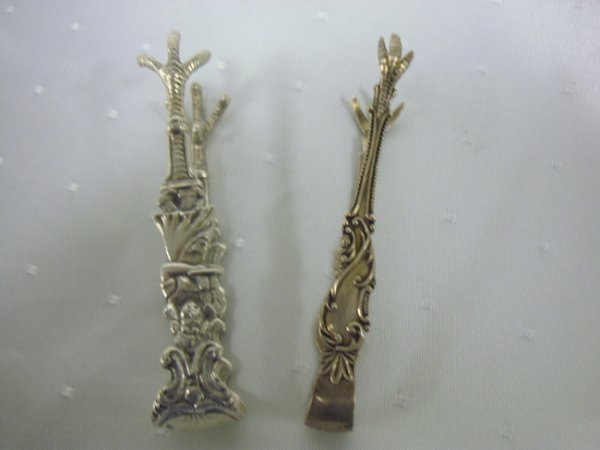 12: TWO STERLING EMBOSSED CLAW SUGAR TONGS; ONE W/YOUNG