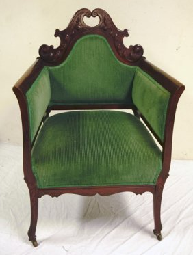 CARVED MAHOGANY UPHOLSTERED ARM CHAIR; 40 1/4 IN