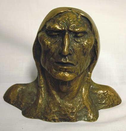 1155: BRONZE INDIAN HEAD BOOKEND; 5 1/4 IN H, 7 IN W