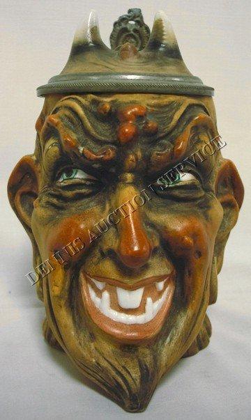 1218: 1/2 LITER DEVIL FACE STEIN; HAS IMPRESSED MARK