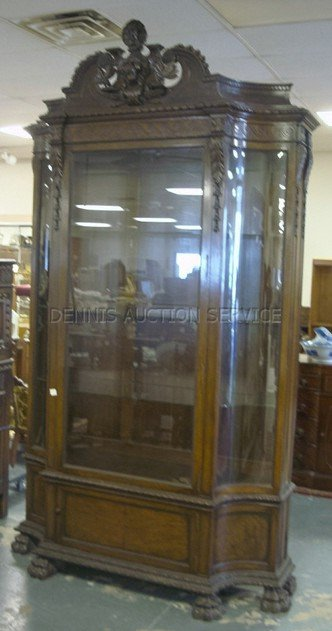 1353: MASSIVE CARVED CHINA CABINET W/LIONS HEAD CREST,
