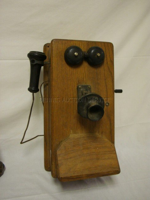 1016: KELLOGG OAK WALL TELEPHONE; 19 IN H, 9 IN W