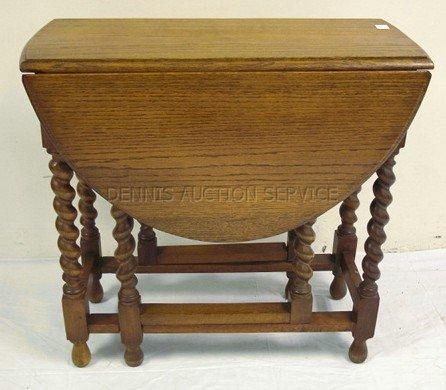 1037: OAK GATE LEG DROP LEAF TABLE W/ROPE TURNED LEGS;