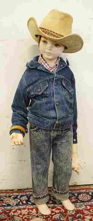 YOUNG BOY MANNEQUIN CLOTHED IN VINTAGE ORANGE TAB LEVIS
