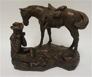 AUSTIN PROD. COWBOY SCULPTURE