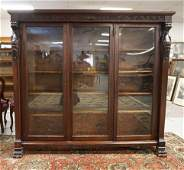CARVED HORNER MAHOGANY 3 DOOR BOOKCASE