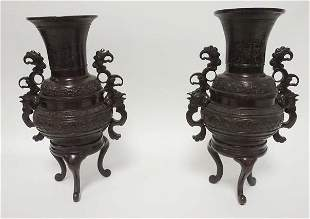 PAIR OF BRONZE ASIAN FOOTED URNS