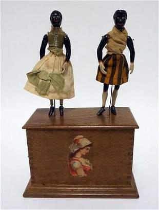 ANTIQUE CLOCKWORK DANCING DOLLS