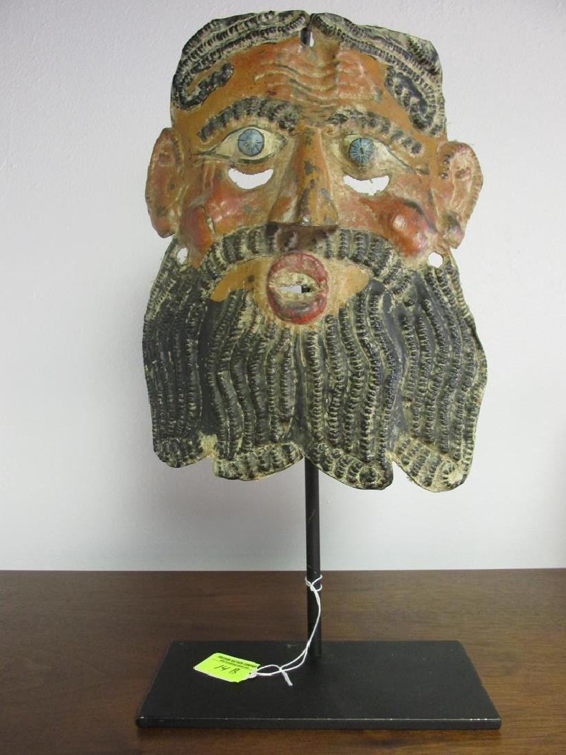 METAL FORMED MASK ON IRON STAND