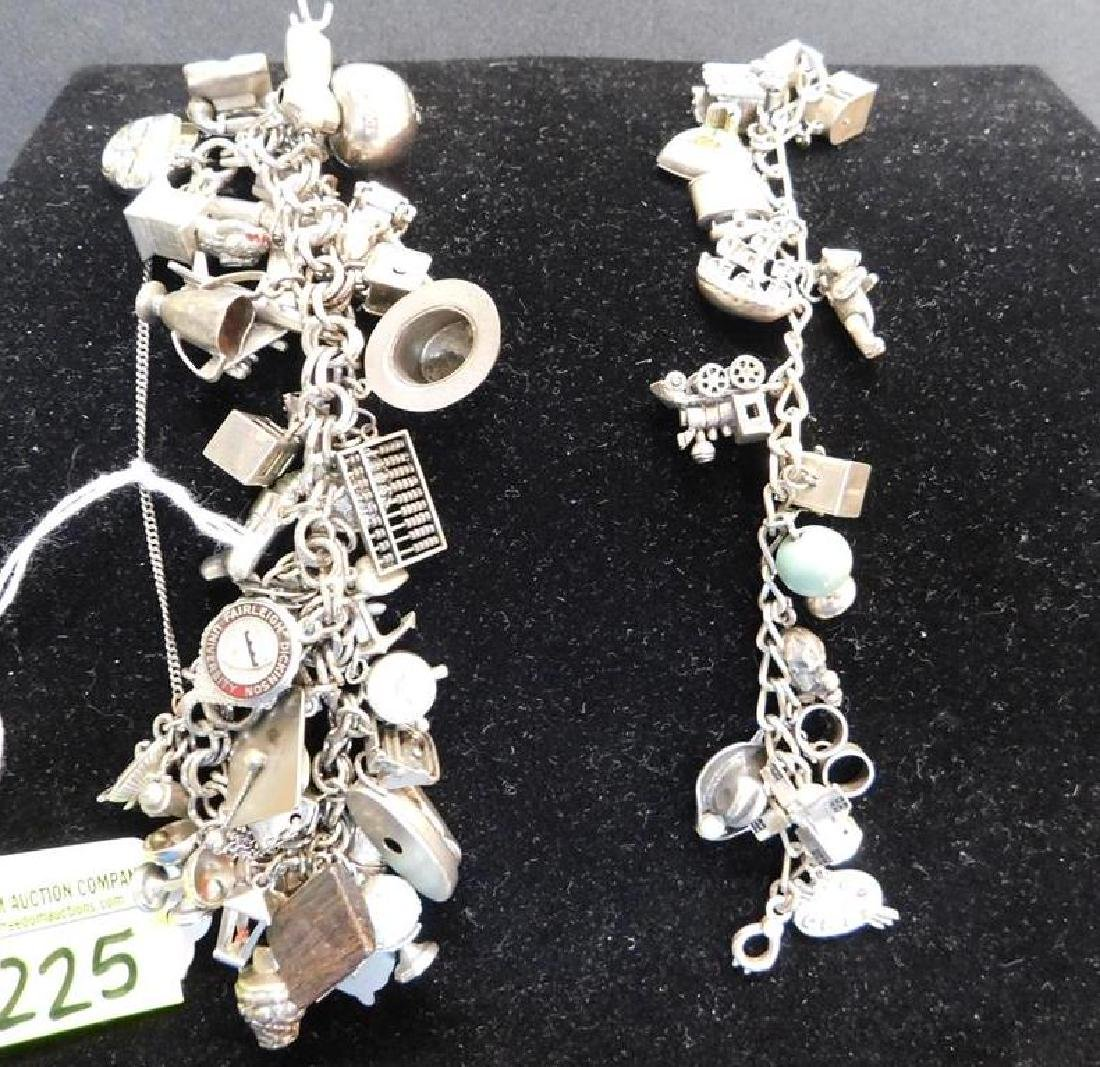 2 CHARM BRACELETS INCLUDING STERLING SILVER