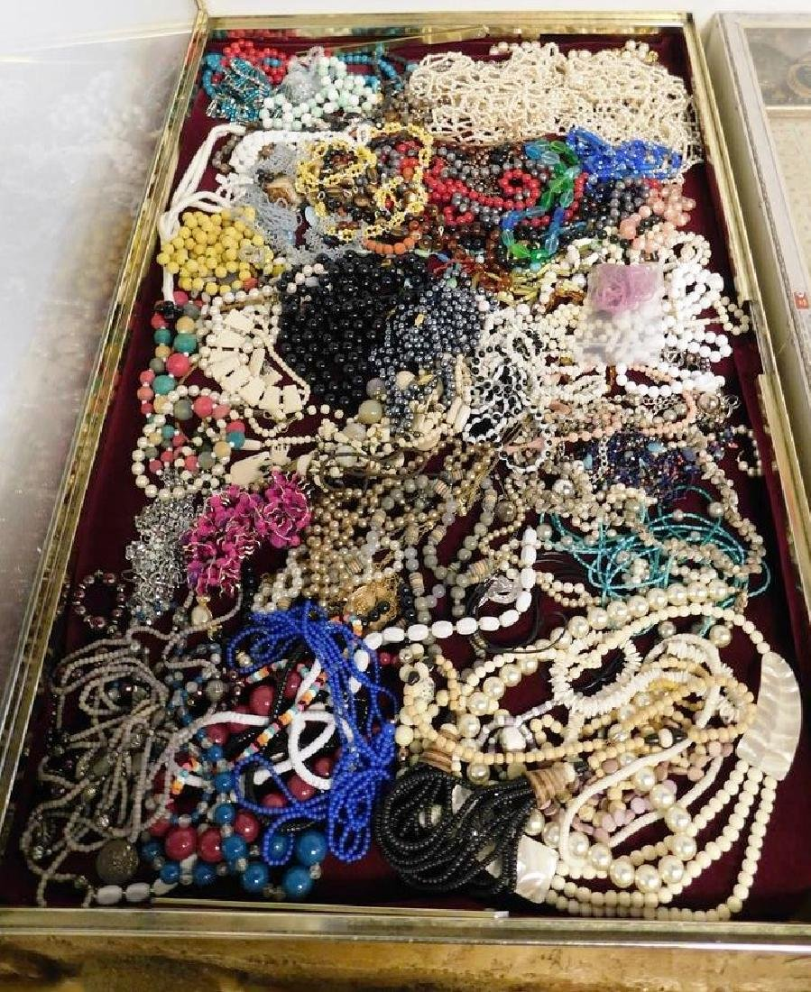 CASE LOT OF BEADED AND COSTUME JEWELRY