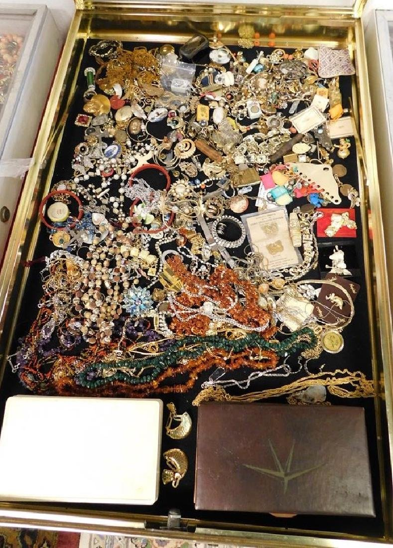 CASE LOT OF COSTUME JEWELRY