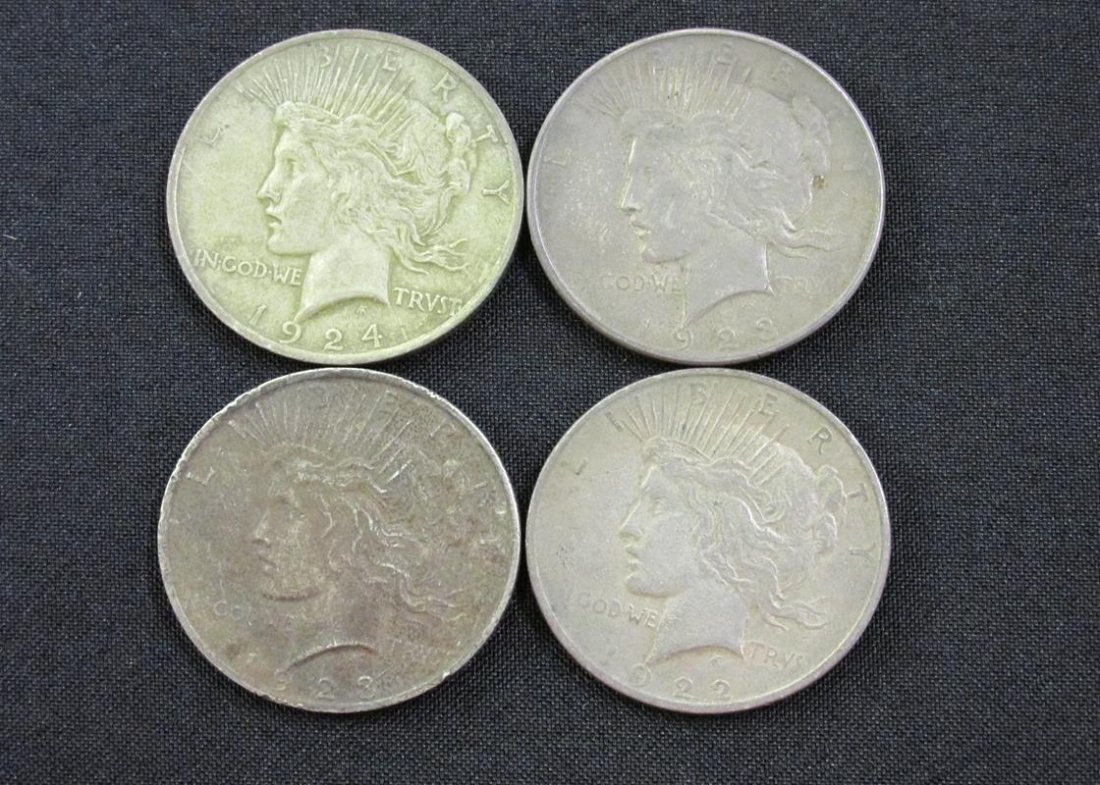 LOT OF 4 MIXED DATE PEACE SILVER DOLLARS