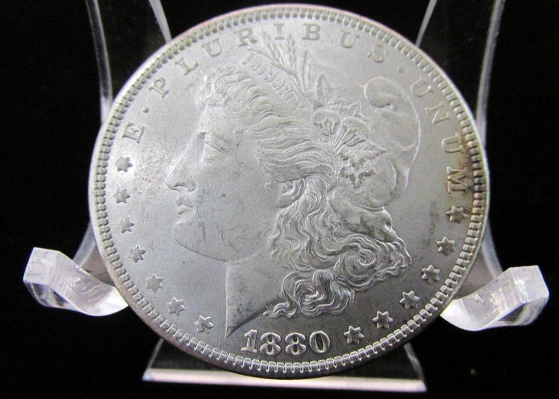 1880 MORGAN SILVER DOLLAR, UNC.