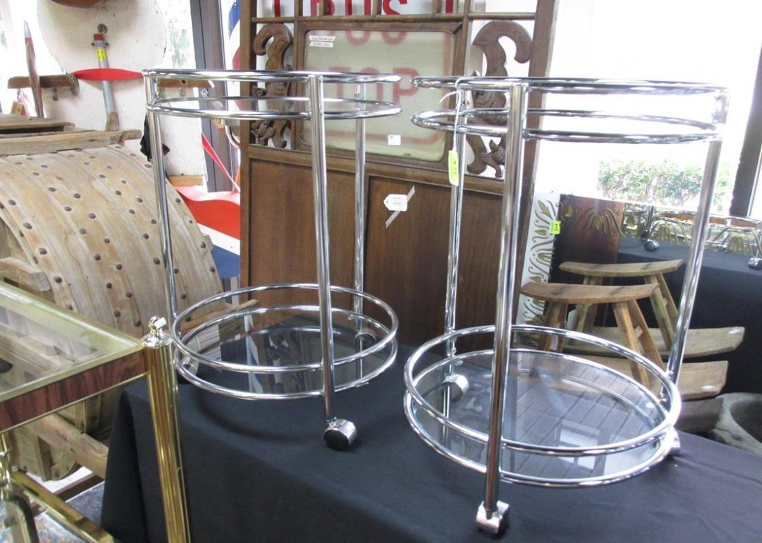PAIR OF ROUND CHROME CASTERED TABLES