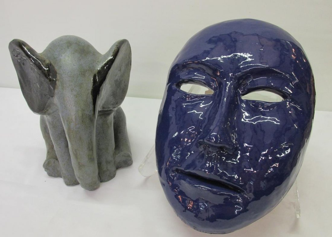 ELEPHANT AND MASK POTTERY PAIR