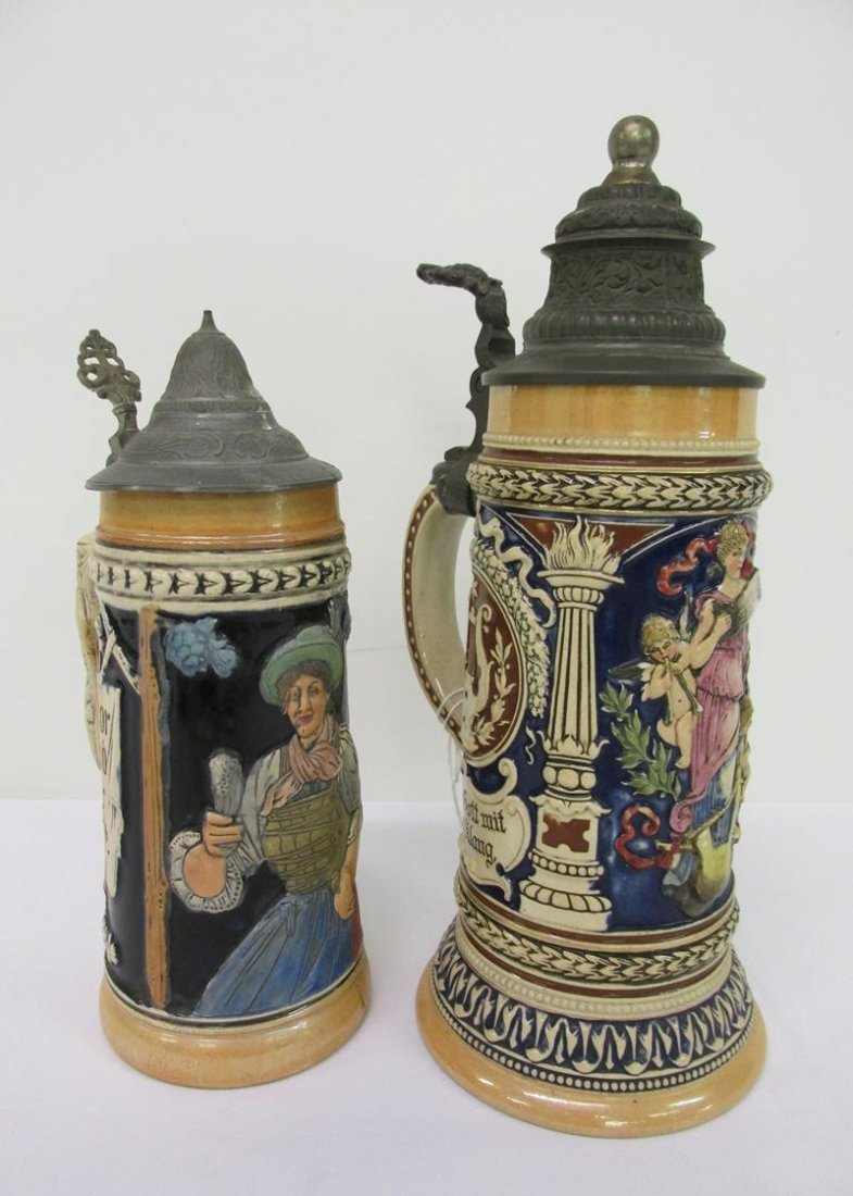 PAIR OF EARLY 1900'S GERMAN LIDDED STEINS