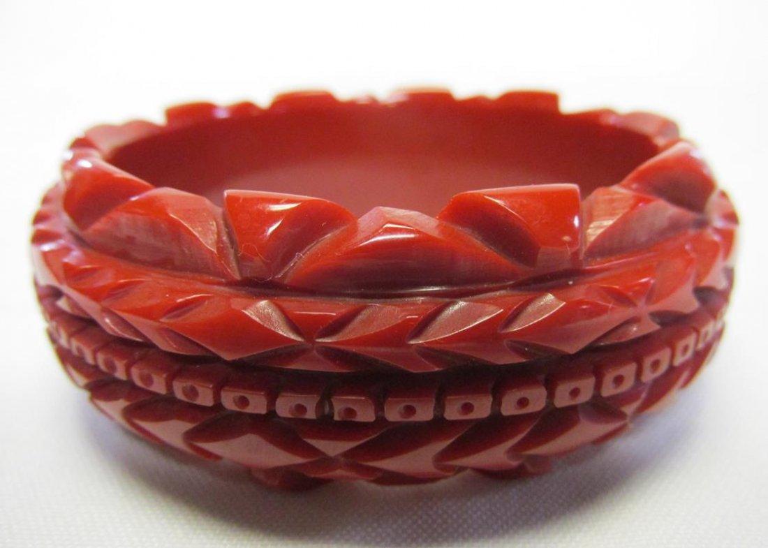 RED BAKELITE CARVED BAKELITE BANGLE BRACELET