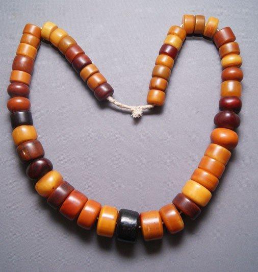 145: strand of Amber