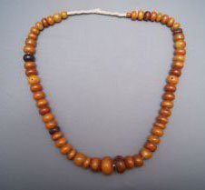 228: STAND OF AMBER BEADS