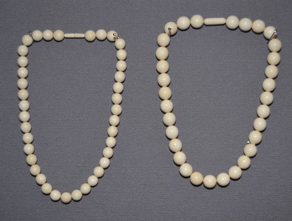 TWO IVORY NECKLACES