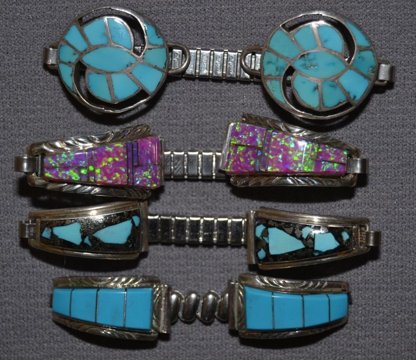 COLLECTION OF FOUR SETS OF NAVAJO SILVER WATCH TIPS