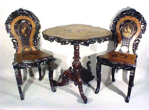 6: Antique Carved Black Forest Table and Chairs