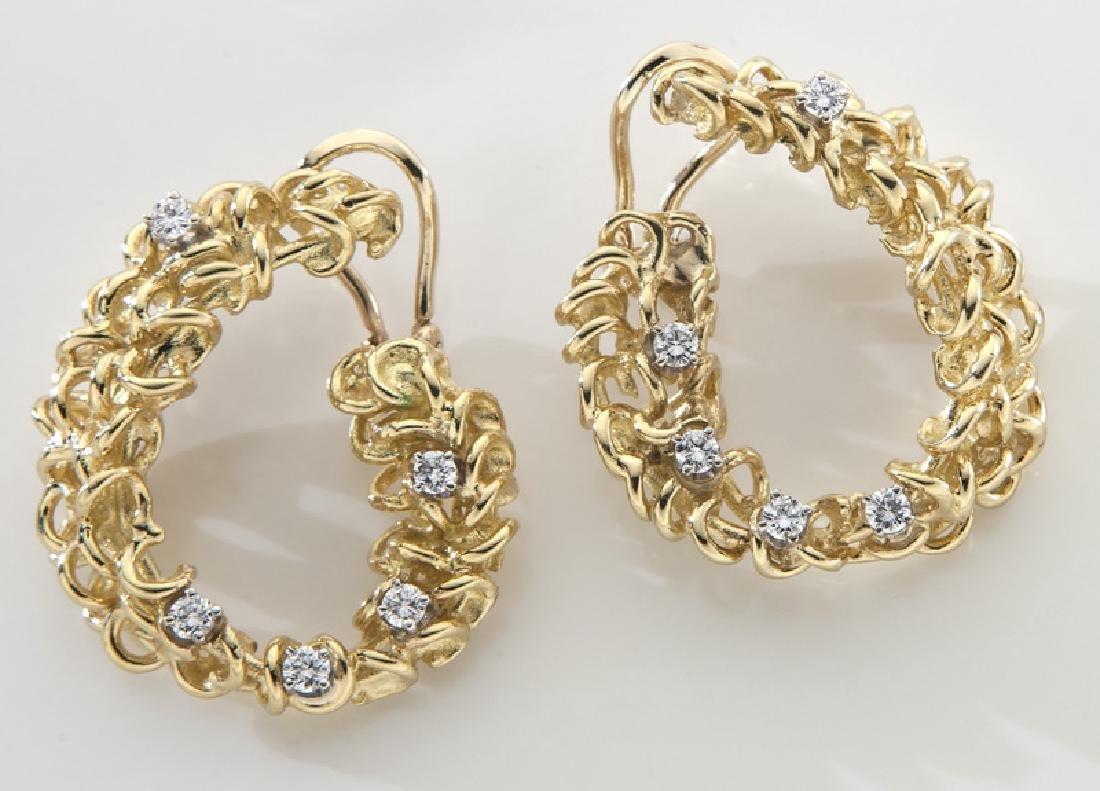 Pair 18K gold and diamond earrings.