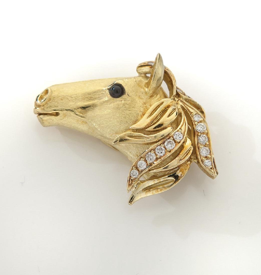 18K gold, diamond and onyx horse's head clip.