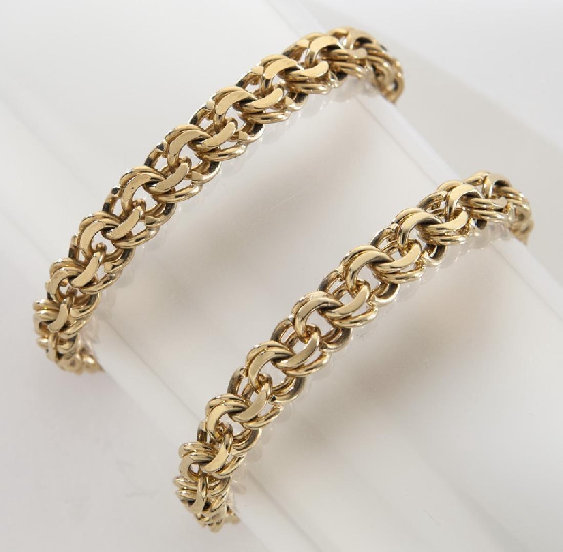 (2) 14K yellow gold charm bracelets.