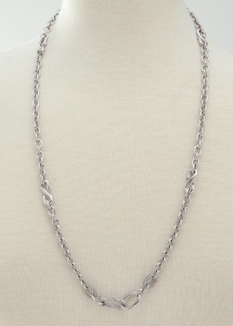 Italian 18K white gold and diamond link necklace.