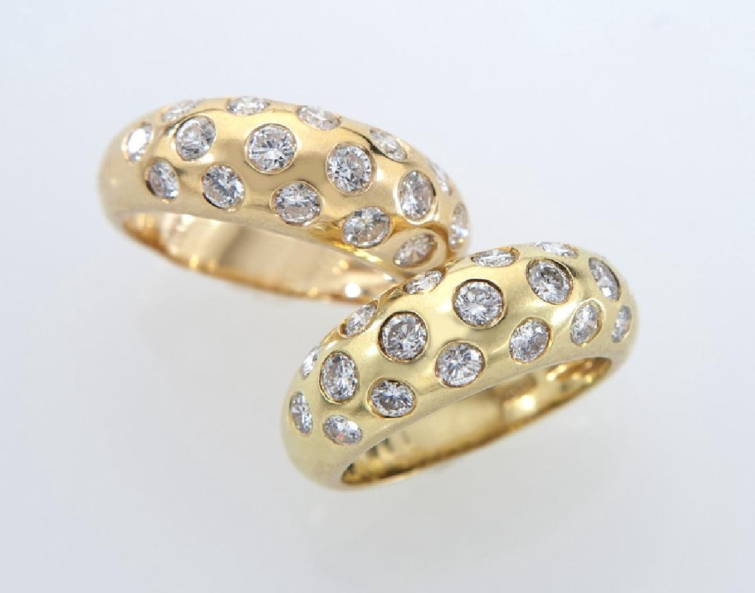 (2) Giovani 18K gold and diamond dome rings,