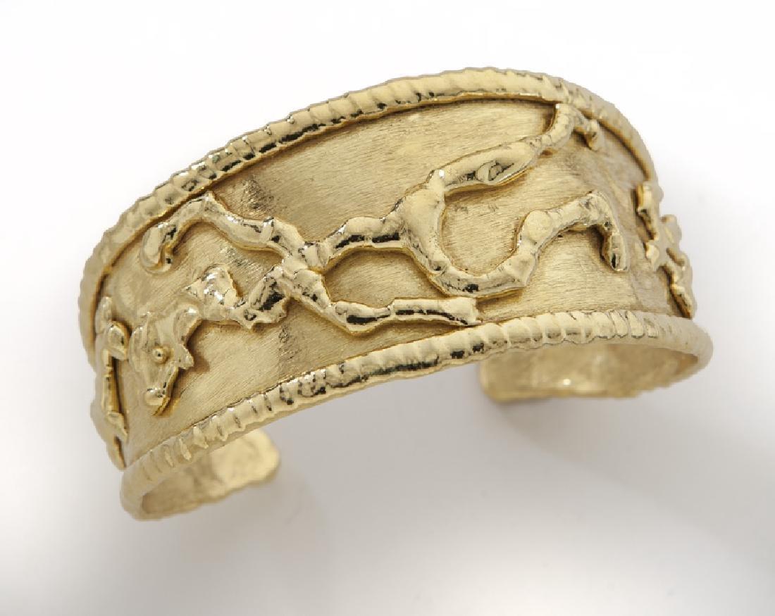 Jean Mahie 22K tumbling figures cuff bracelet.
