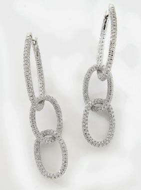 Pair Garavelli 18K gold and diamond hoop earrings