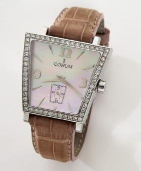 Corum Trapeze stainless and mother of pearl watch.