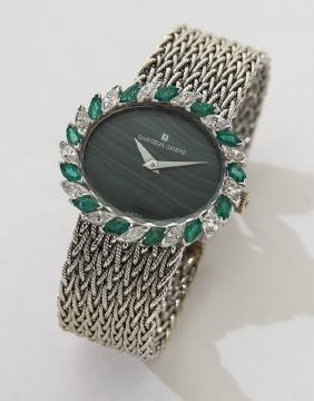 Universal 18K gold, diamond and emerald watch