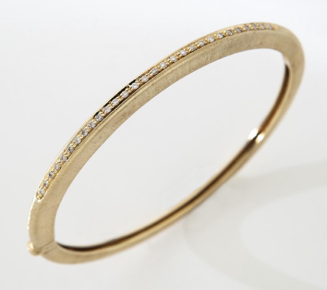 18K yellow gold and diamond bangle bracelet.