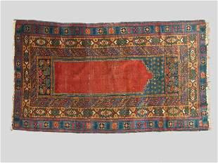 An Antique Turkish Oriental rug.