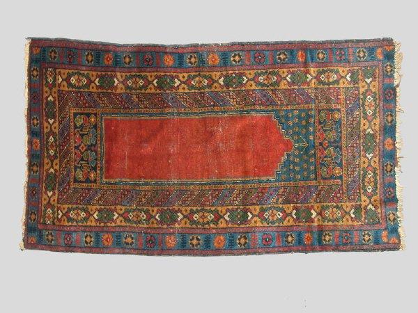 6: An Antique Turkish Oriental rug.