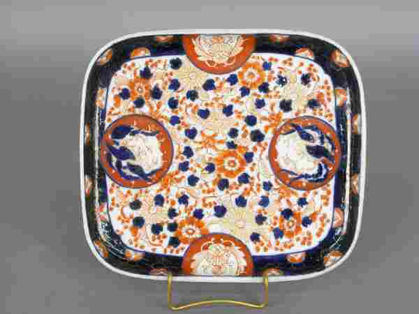 A rectangular Imari tray with a floral red and