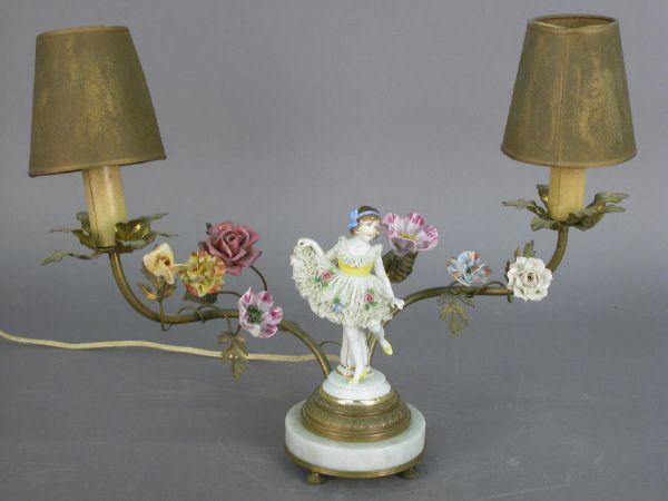 A vintage 2-light lamp with porcelain floral