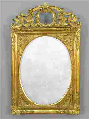 A gilt carved mirror. Some damage.