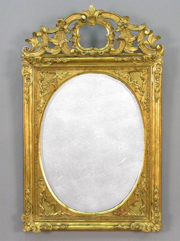 19: A gilt carved mirror. Some damage.